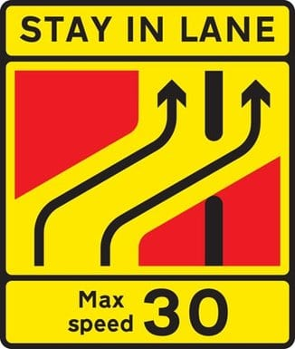 Road sign for one lane crossover at contraflow road works